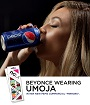 Beyonce wearing the 'UMOJA' NCLA nail wraps in her new Pepsi commercial ! Manicure by Lisa Logan. Click image to view product.